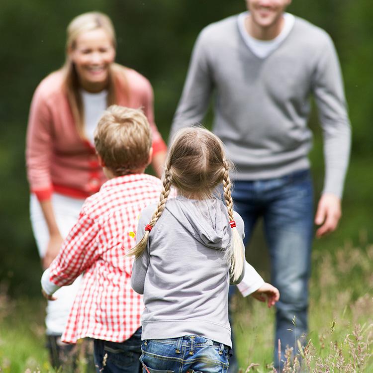 Children running towards parents