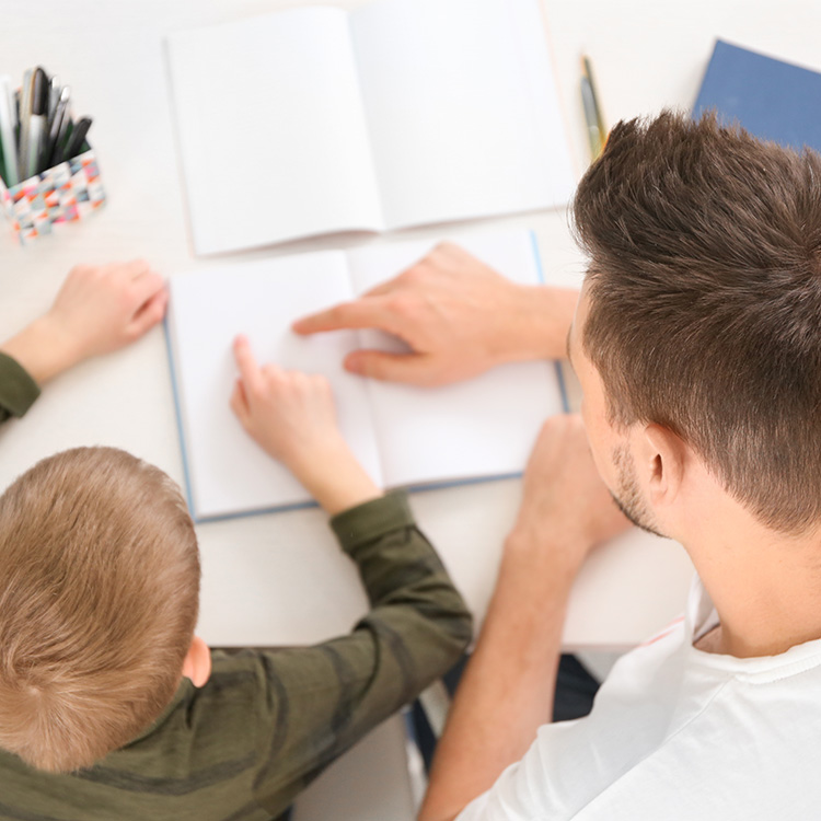 An adult helping a child with homework